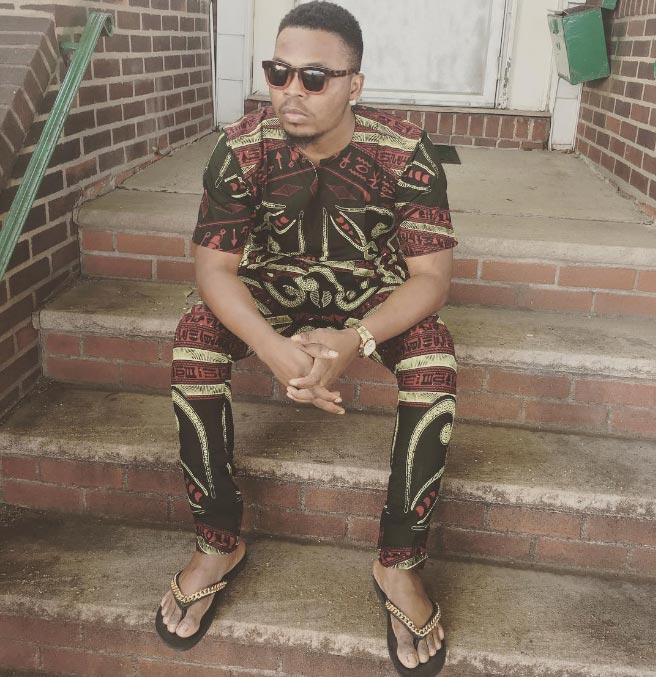 "Olamide ""Baddo"" Ayodeji in print clothes matched with slippers"