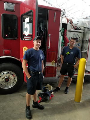 2 firefighters at the new fire station #5.