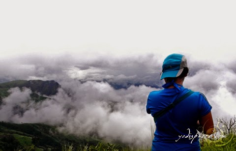 Mountaineer enjoying the clouds at the summit of Mt. Cinco Picos Peak hover_share