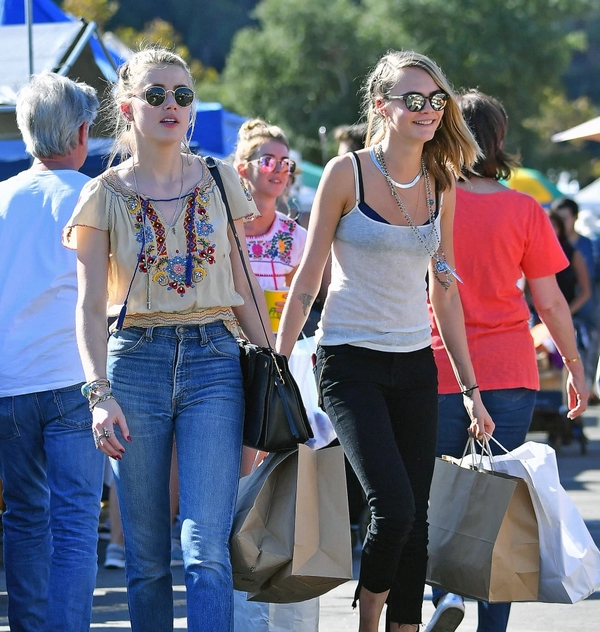Amber heard and Cara Delevingne together