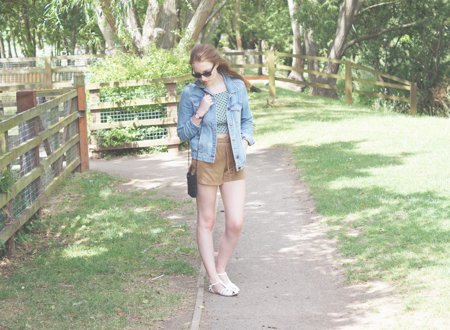 blue denim jacket and suede brown shorts