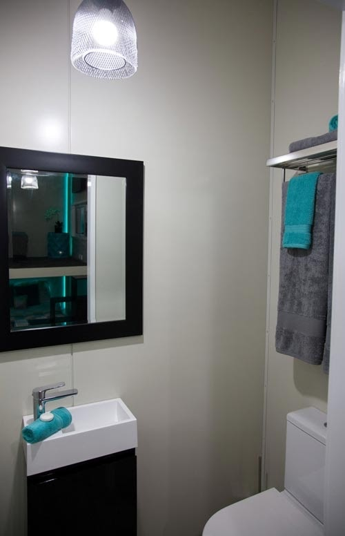 09-Shower-Room-NZ-Tiny-House-Minimalist-and-Space-Age-Architecture-www-designstack-co