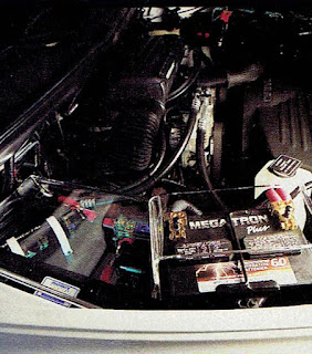 image in color of the engine compartment of Matt Billmeier's 1995 Dodge Ram truck  highlighting the upgraded batteries