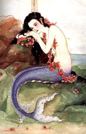 Brunette Asian mermaid resting on coral