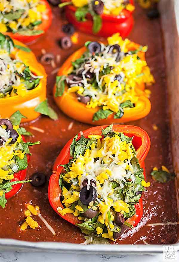 Vegetarian Stuffed Peppers a top tomato sauce with melted cheese in a baking dish ready to serve for dinner