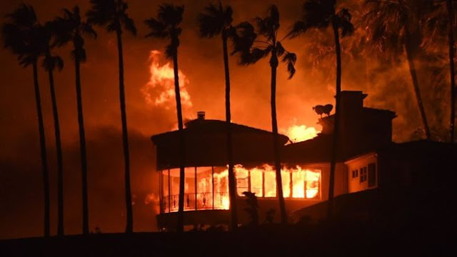 California wildfires: Malibu homes burn as death toll climbs to nine