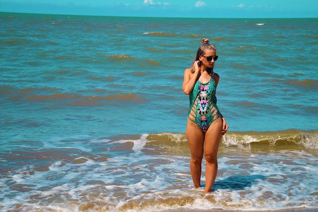 curvy girl on beach in cut up swimsuit aztec style australian beach girl