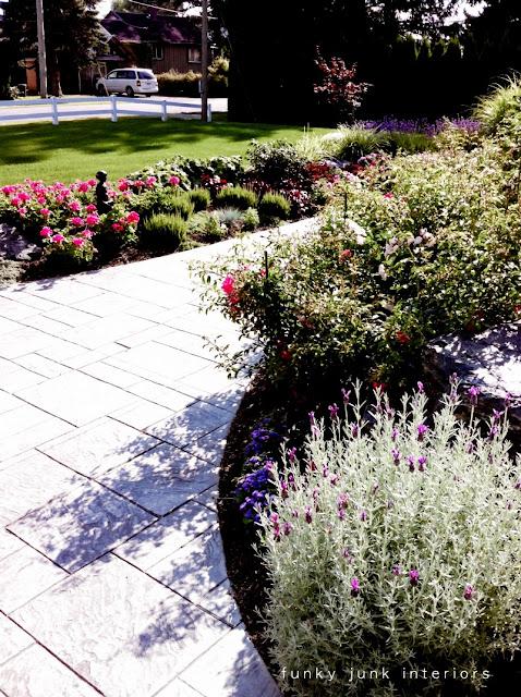stamped sidewalk with flowerbeds