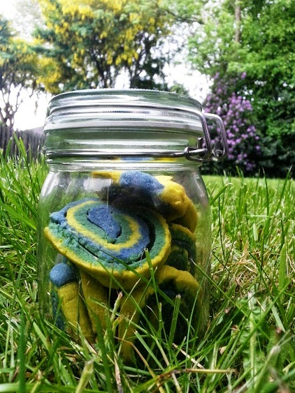 Yellow, green, blue cookies in jar