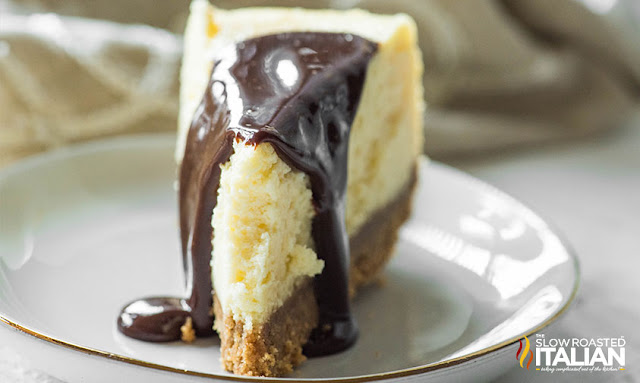 Best Ever Crockpot Cheesecake with chocolate sauce