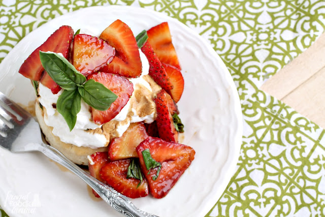 Soft, moist homemade shortcakes are topped with a sweet & tangy strawberry basil topping in these perfect for summer Strawberry Basil Sour Cream Shortcakes.