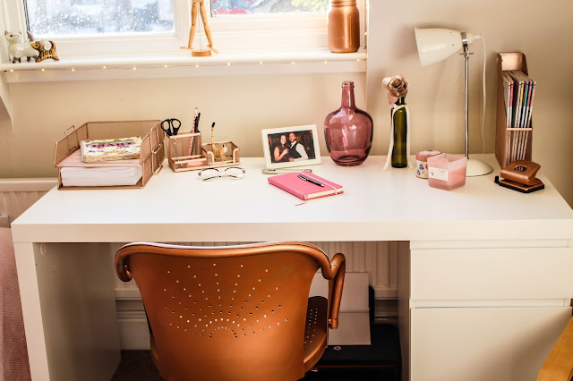 Photo of a rose gold, white and pink office