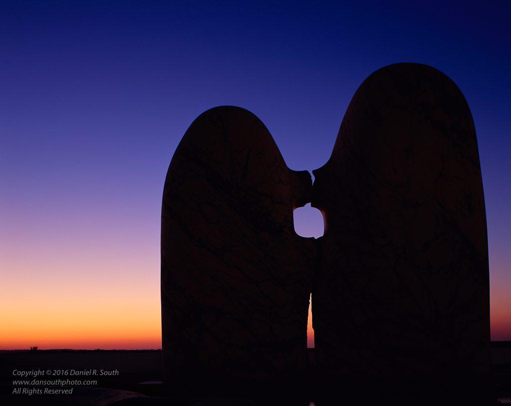 a photo of a sculpture from evora portugal of two abstract figures in love