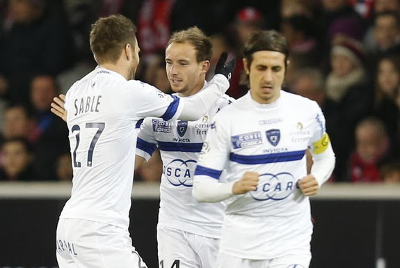 Ludovic Genest celebrates with Bastia teammates after scoring a goal against Lille