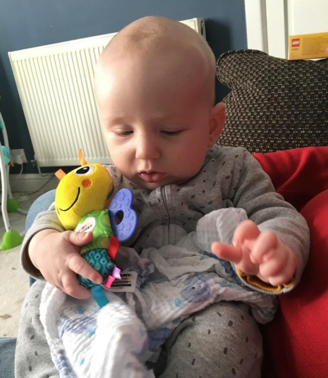 baby-holding-lamaze-toy