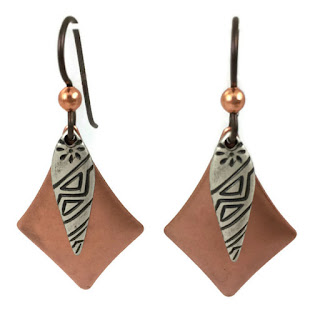 Copper colored and steel earrings with a tribal design