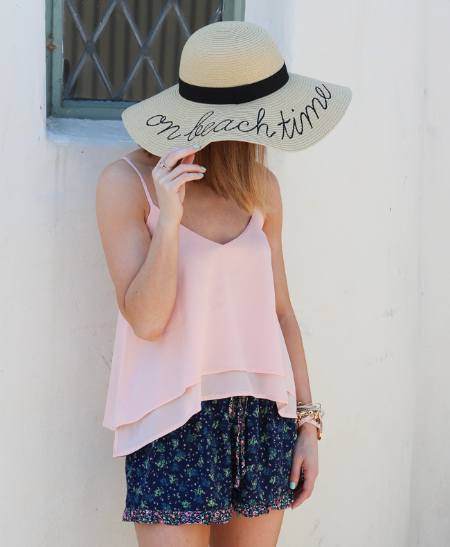 sun hat with pink cami and floral shorts