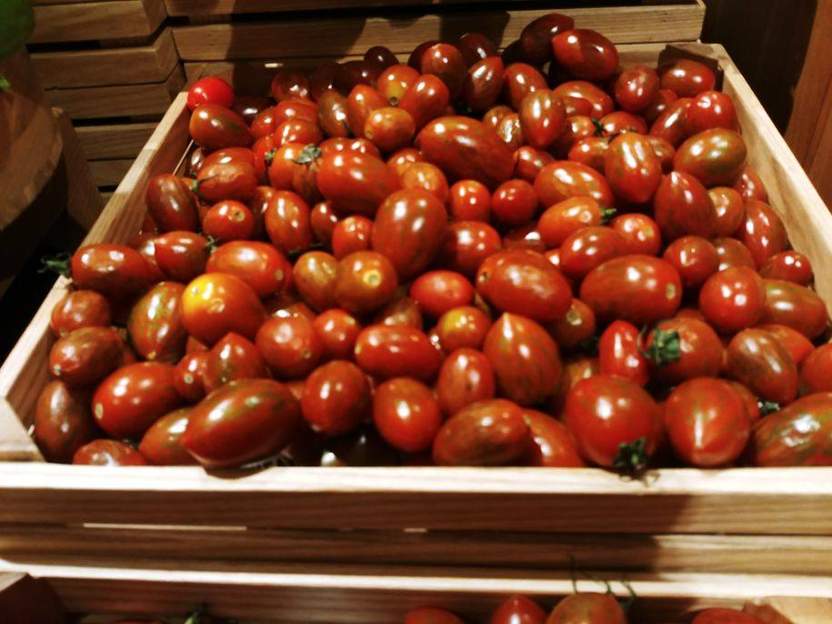 Fresh and bright red cherry tomatoes at The Grand Kitchen