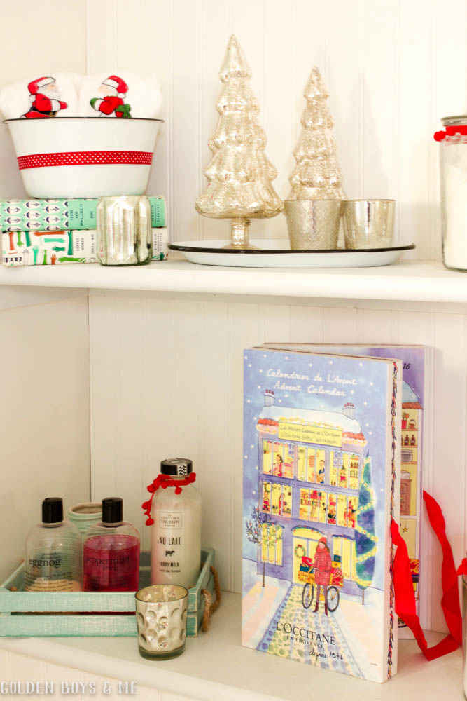 DIY built in shelves in master bathroom with Christmas decor, mercury glass  and L'Occitane Advent Calendar