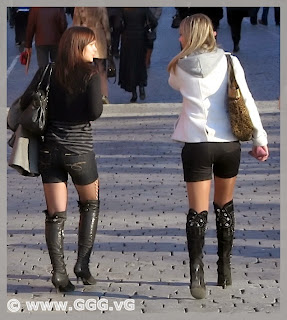 Girls in high heel boots on the street