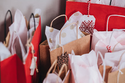 red and brown gift bags with snowflake tags and white tissue paper