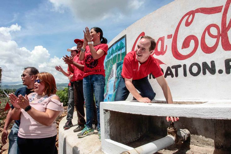 Coca-Cola executives leading the opening of the water pump as part of its Agos Program