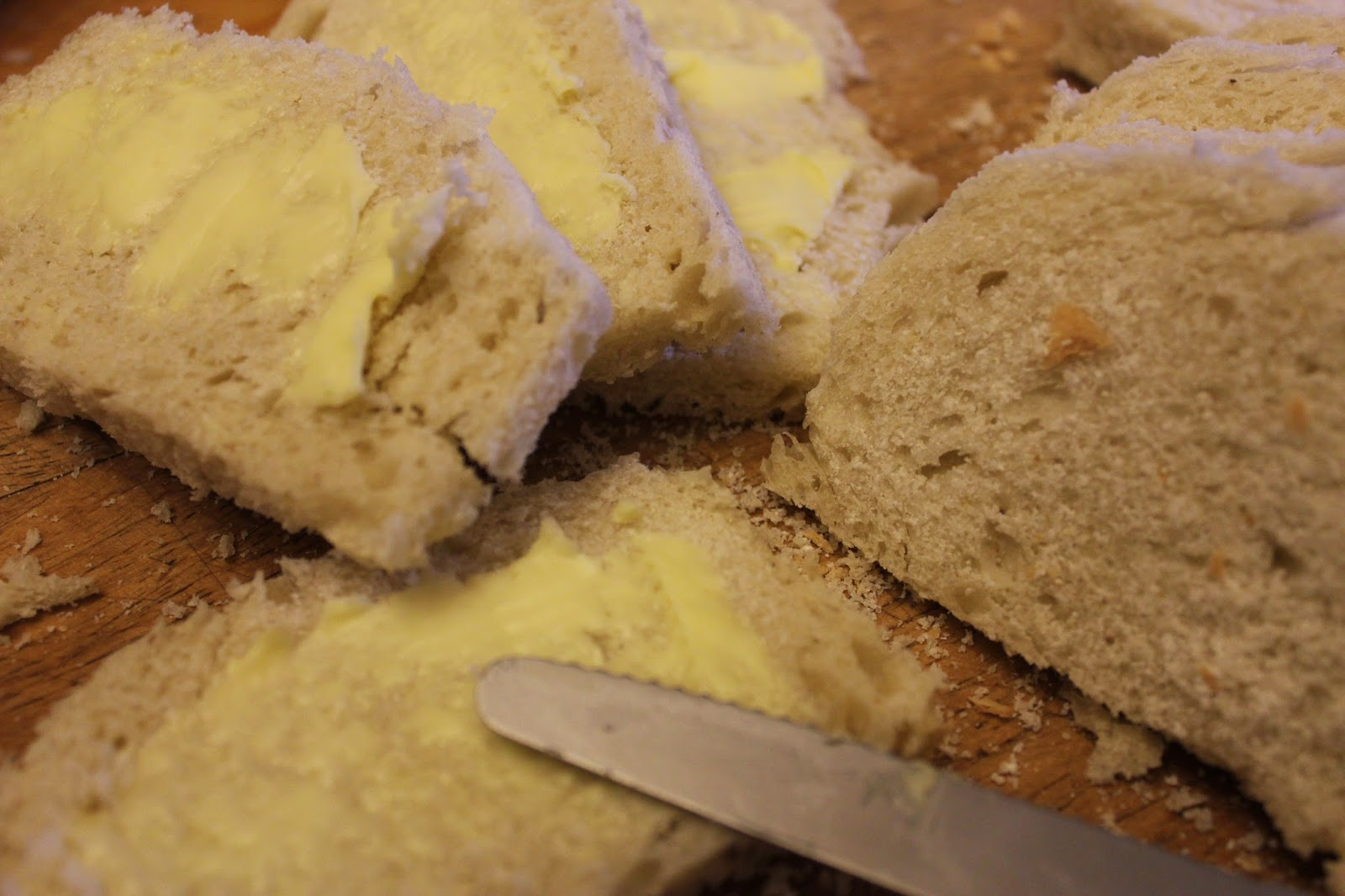 Buttering bread for organic bread and butter pudding recipe