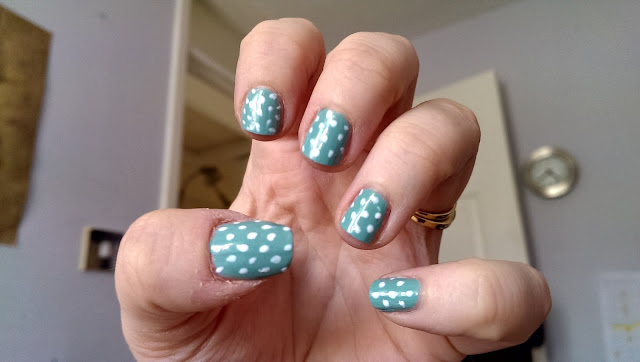 Teal and white polka dot manicure