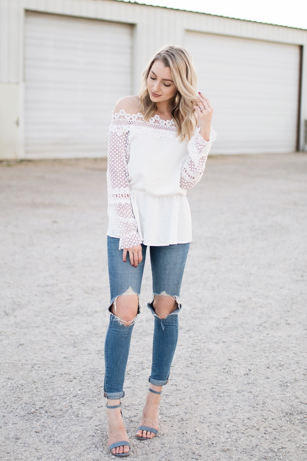 feminine lace top with ripped jeans