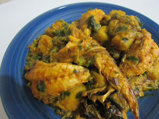 Yam porridge with fish and vegetables