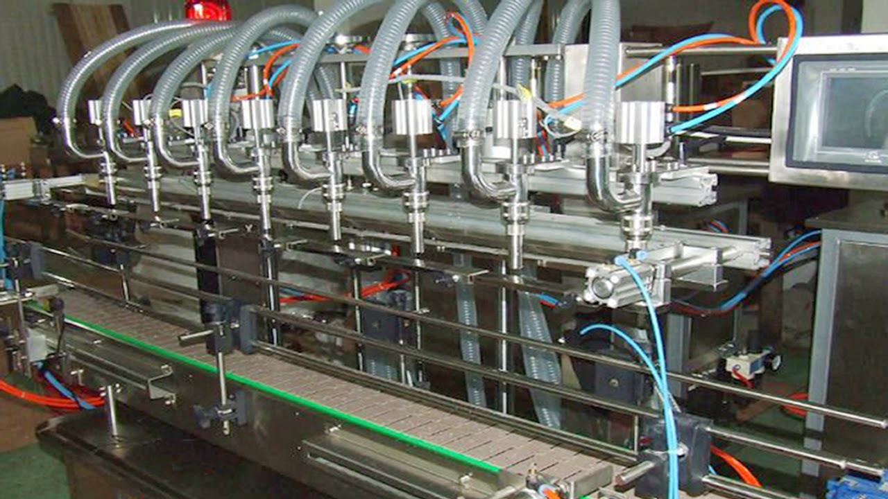 Paste filling machine with 4 nozzles for glass bottles Automatische Abfuellmaschine fuer Glasflasche