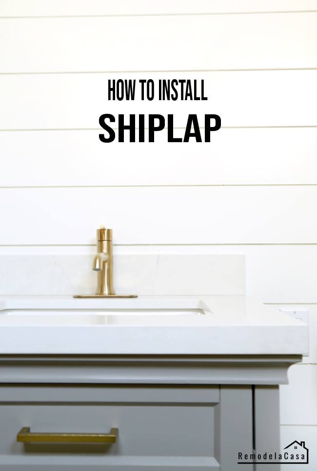 shiplap being installed around vanity in bathroom
