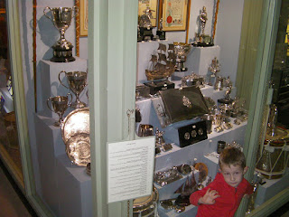 regimental silverware collection, trophies of war in museum display cabinet