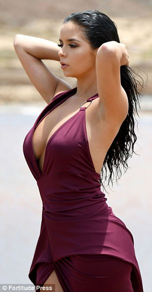 Demi Rose Mawby Flaunts Sensational Curves In Plunging Dress