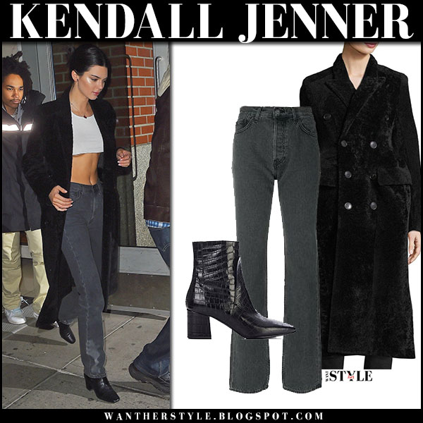 Kendall Jenner in long black coat balenciaga, crop top and jeans yeezy model street style january 26