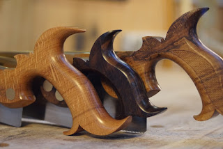 Three wooden saw handles
