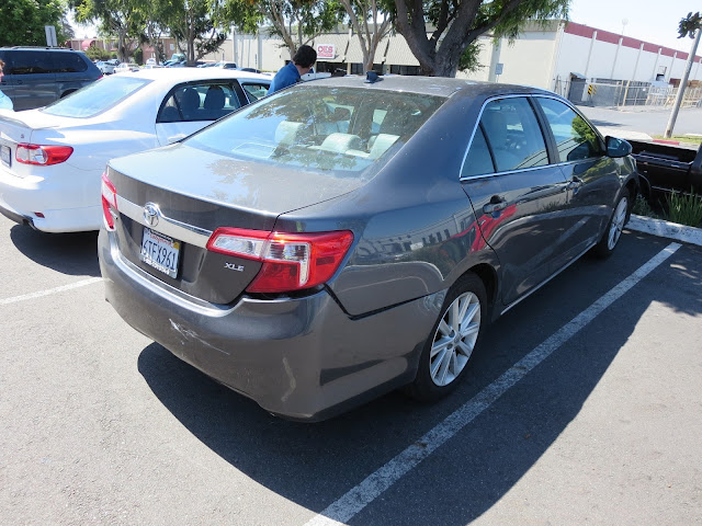 Toyota Camry with rear end damage from collision before repairs at Almost Everything Auto Body.