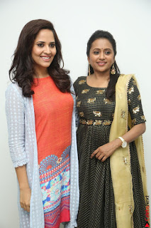 Actress Suma in Black Salwar Suit and Anusuya in orange Dress at winner movie press meet part 1 February 2017 (21).JPG