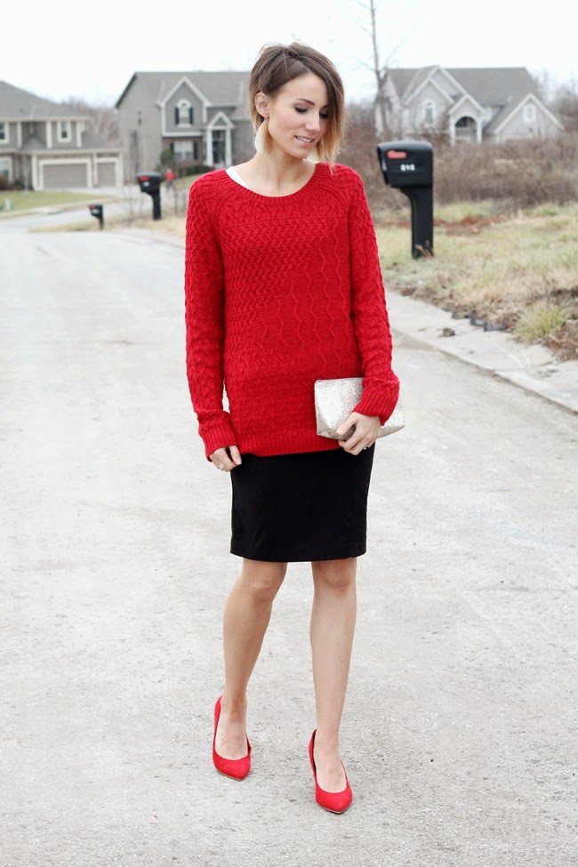 Red sweater, black skirt, red heels