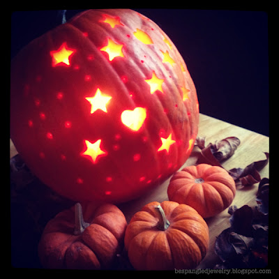 Halloween pumpkin carved with cookie cutters, stars and hearts shape
