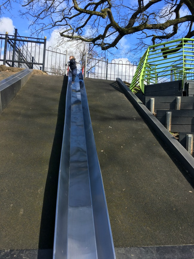 boy-at-top-of-slide-at-Roath-park-cardiff