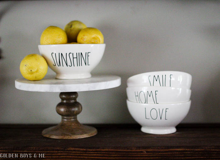 Rae Dunn bowls in farmhouse style dining room