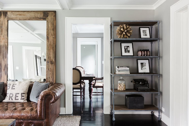 Modern farmhouse living room with leather tufted sofa on Hello Lovely Studio