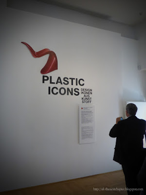 Photo of red plastic chair and the text Plastic Icons