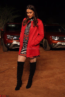 Neha Dhupia in Lulu and sky dress and Zara jacket and Stuartz wietzmen boots(1) ~ .jpeg