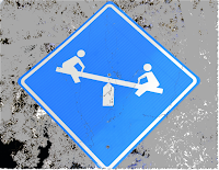 A road sign of a teeter-totter