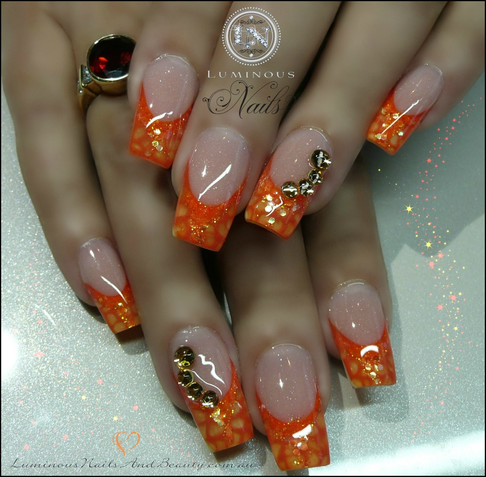 Magnificent Orange And Gold Halloween Nails