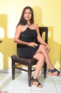 Vrushali Gosavi in strapless Short Black Dress At Follow Follow U Audio Launch 032.JPG