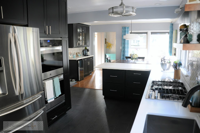 Modern, updated kitchen with open lay out, black cabinets and double oven :: OrganizingMadeFun.com