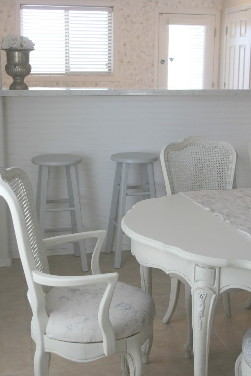 Shabby chic white cane back dining chair with linen fabric seat by Hello Lovely Studio